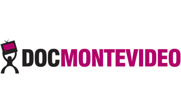 DOCMONTEVIDEO logo, picturing on its left side a stylised black silhouette with wide open legs forming a semicircle, and arms holding up high a black TV set with burgundy screen and black antennas. On the right side DOCMONTEVIDEO is written in capitol letters, DOC being black and MONTEVIDEO burgundy. Right below ENCUENTRO DOCUMENTAL DE LAS TELEVISORAS LATINOAMERICANAS is written with small capitol letters, being TELEVISORAS in burgundy and the rest in black.